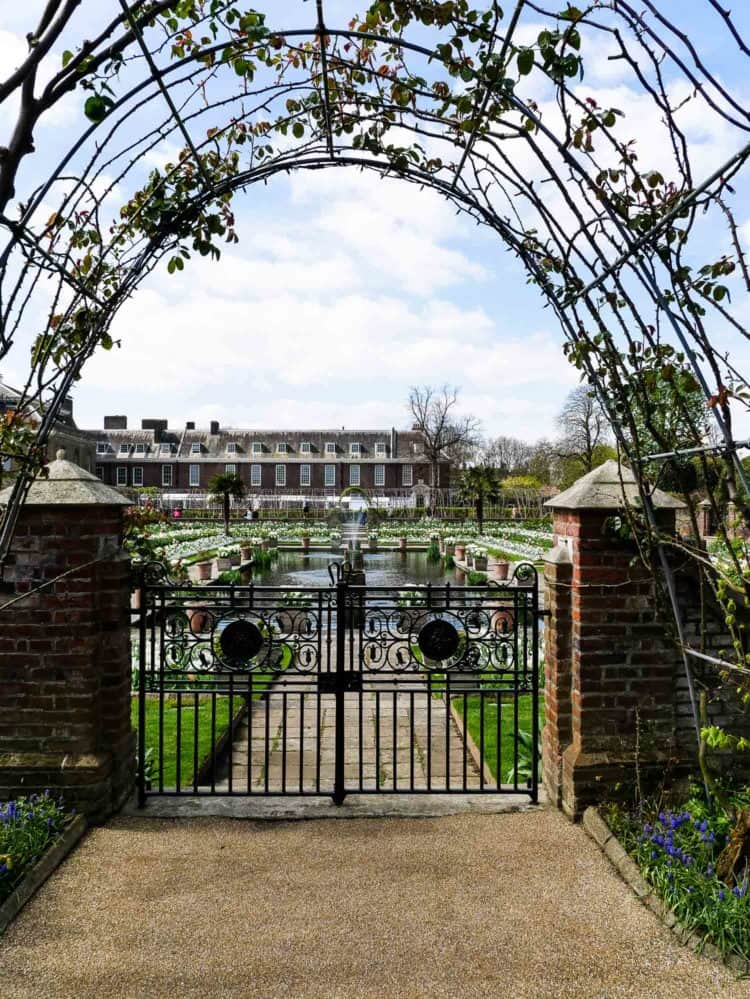 A wrought iron gate and arch in Kensington Palace garden.