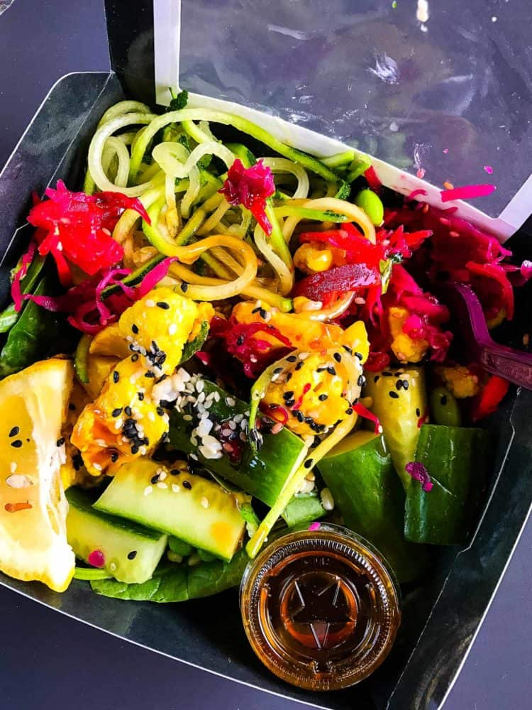 Zucchini, beets, cucumber, and sesame seeds in a salad at Pret in London.