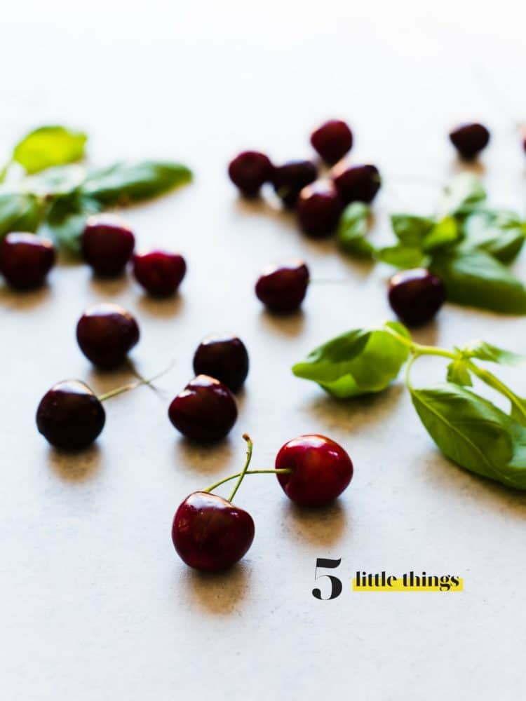 Fresh cherries spread out on a countertop.