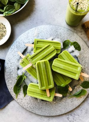 Popsicles for breakfast? Yes, you can with healthy Green Smoothie Popsicles! Turn your favorite green smoothie into an icy treat for anytime of day, especially after a workout!