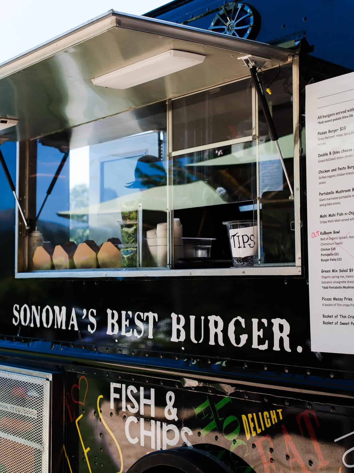 The order window of a food truck selling hamburgers.
