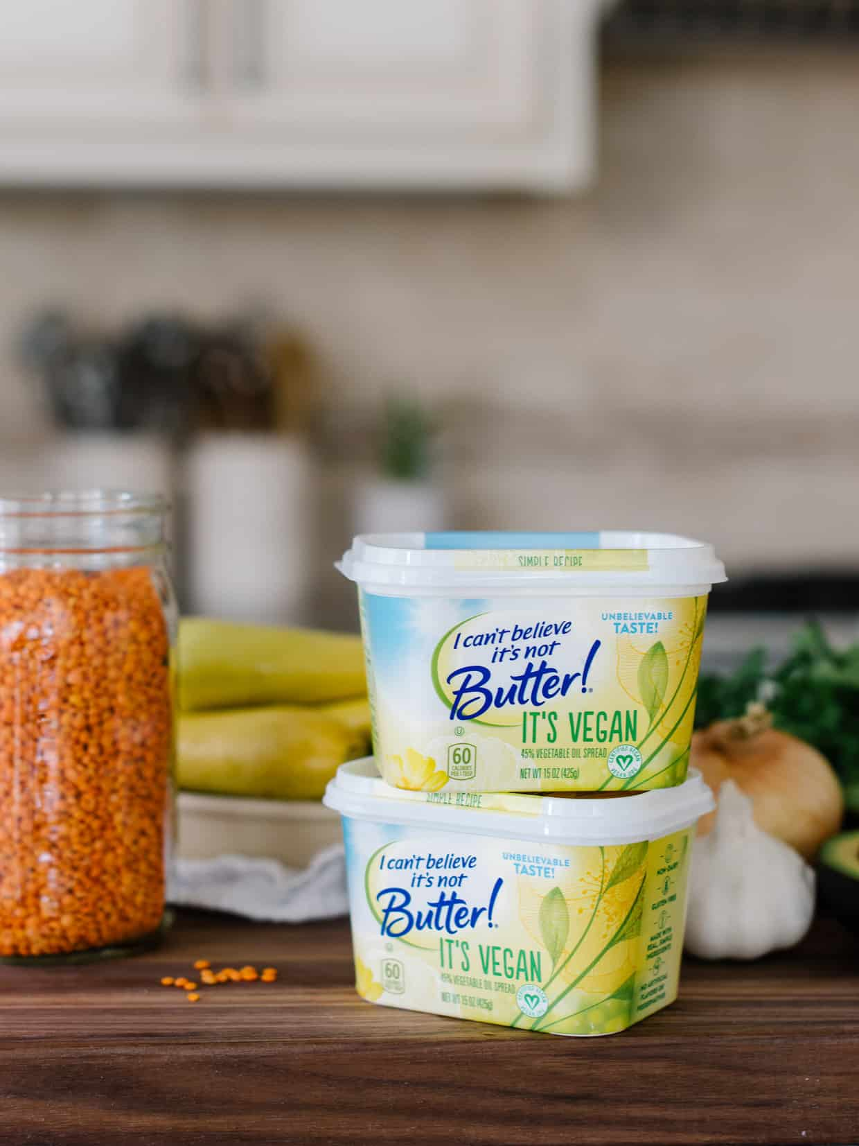 Containers of I Can't Believe It's Not Butter! It's Vegan and a jar of red lentils to make Lentil Stuffed Summer Squash.