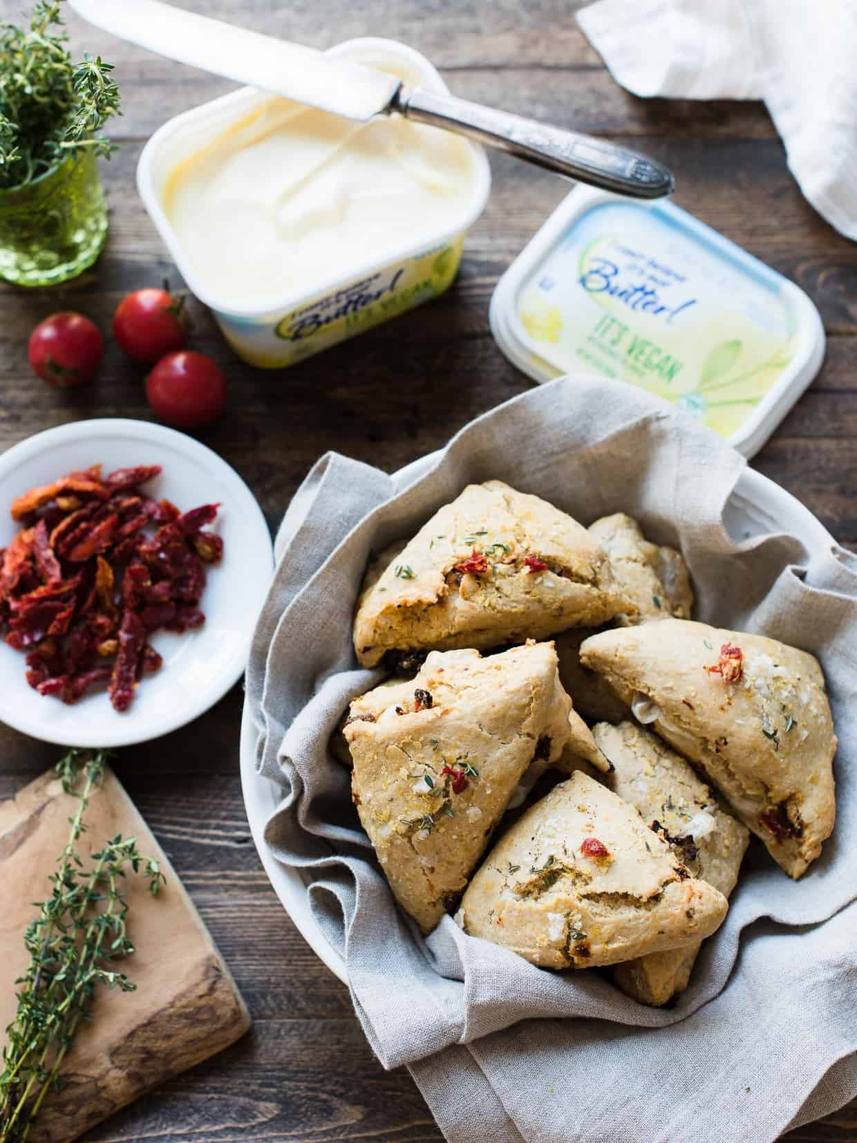 There's nothing more comforting than a warm, savory scone fresh out of the oven. These Sun-dried Tomato and Thyme Scones are savory and cheesy, and may surprise you, because they're vegan, too!  Made with @icbinotbutter It's Vegan #ICBINotButterPartner #sponsored