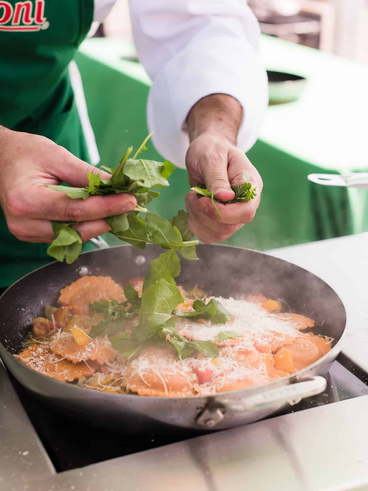 Buitoni Chef Riccardo Landi transforming Buitoni refrigerated vegetable and herb infused pastas into a simple dish using arugula sourced from the farmer's market. #ad
