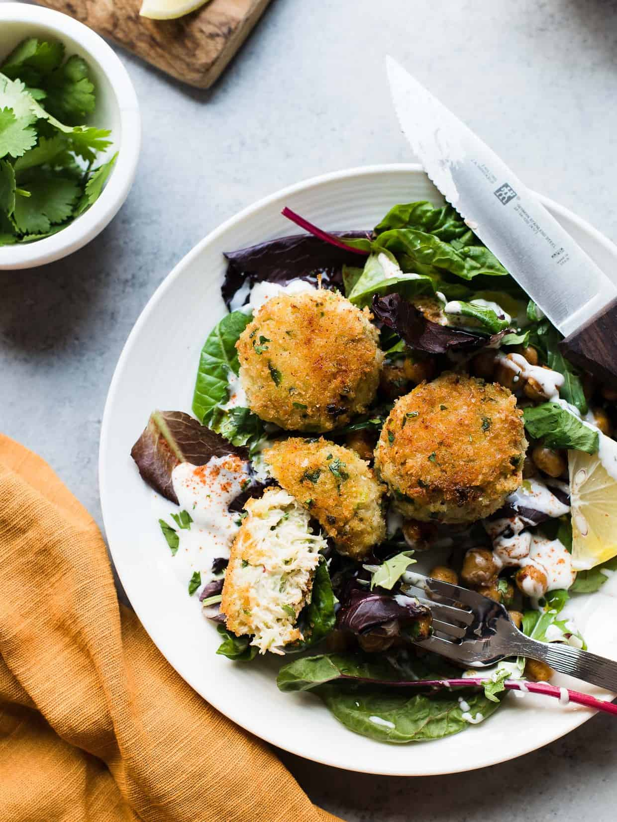 Chickpea Crab Cakes served a top of fresh greens.
