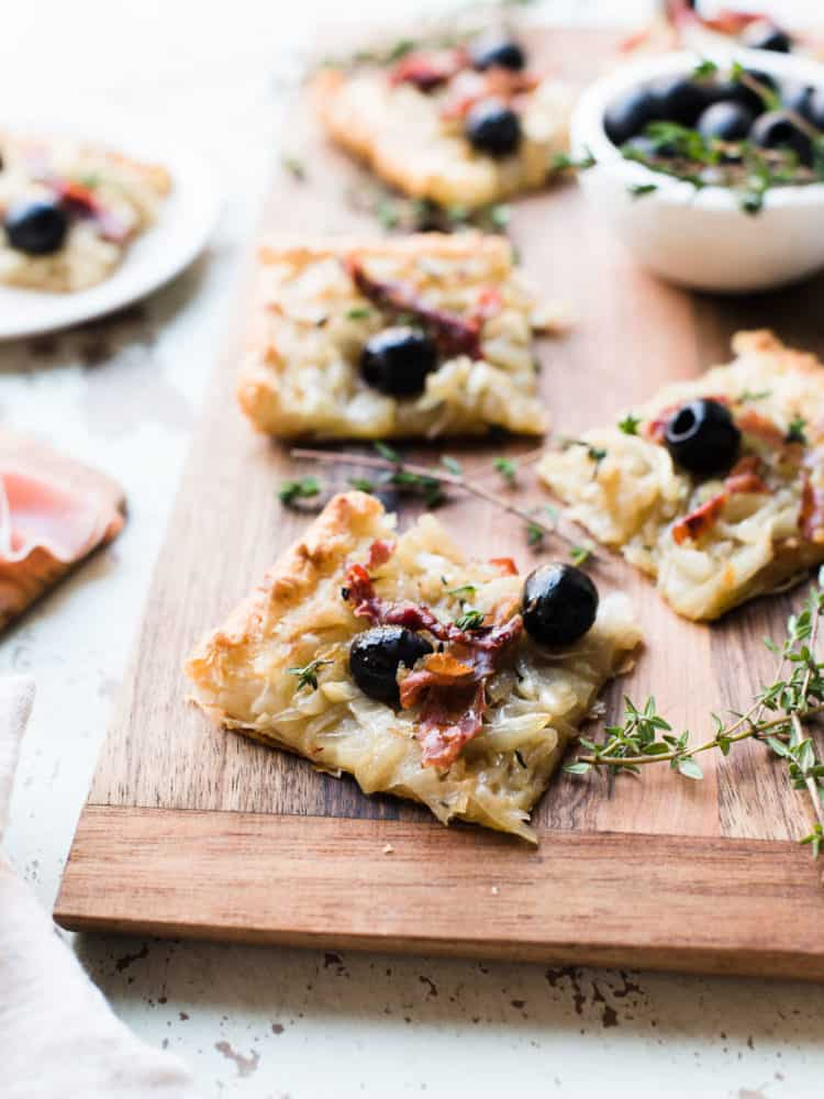 Pissaladière with Prosciutto is a twist on a classic Provencal dish. A puff pastry tart with caramelized onions, prosciutto & olives makes it perfect for entertaining. This recipe is inspired by the time I spent in wine country cooking with Joanne Weir as a guest of Lindsay Olives. This post is brought to you by Lindsay Olives. #ad