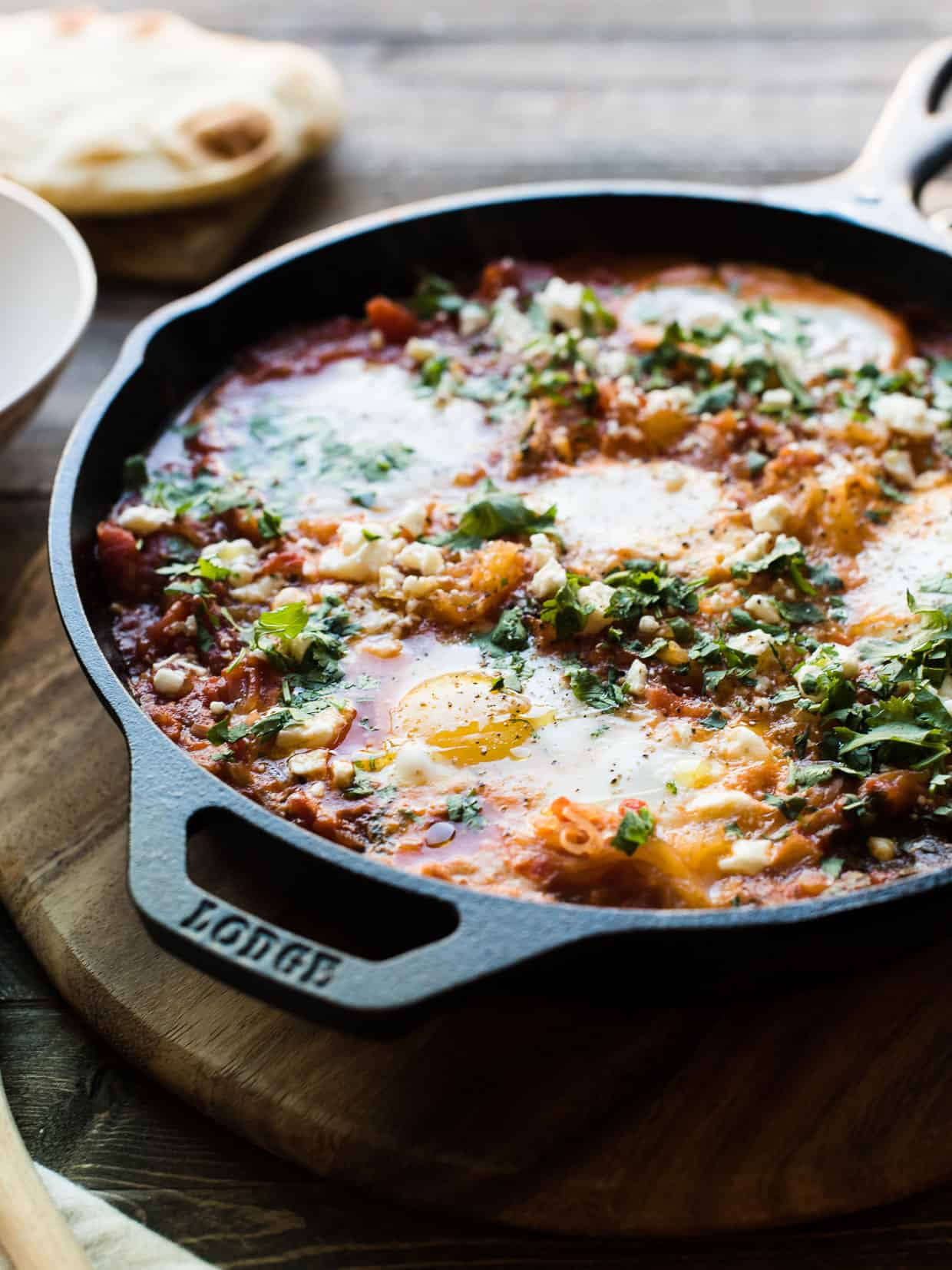 Close up view of a cast iron pan of Spaghetti Squash Shakshuka.