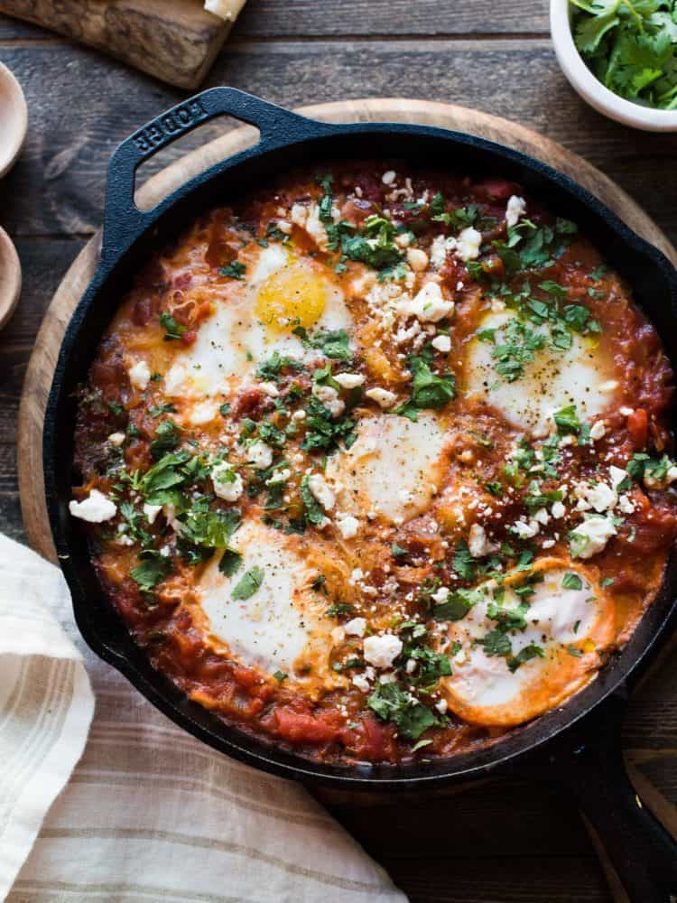 Spaghetti Squash Shakshuka in a cast iron pan.