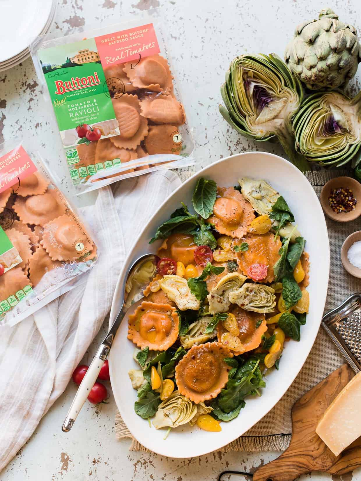 A meal that can go from stove to table in 10 minutes is a dream, especially on busy weeknights. Tomato and Mozzarella Ravioli with Tomatoes, Baby Kale and Artichokes is easy to make with @buitoniusa freshly made pasta, pantry staples and fresh ingredients from the farmer's market! You'll be #CloserToDinner in no time! #ad