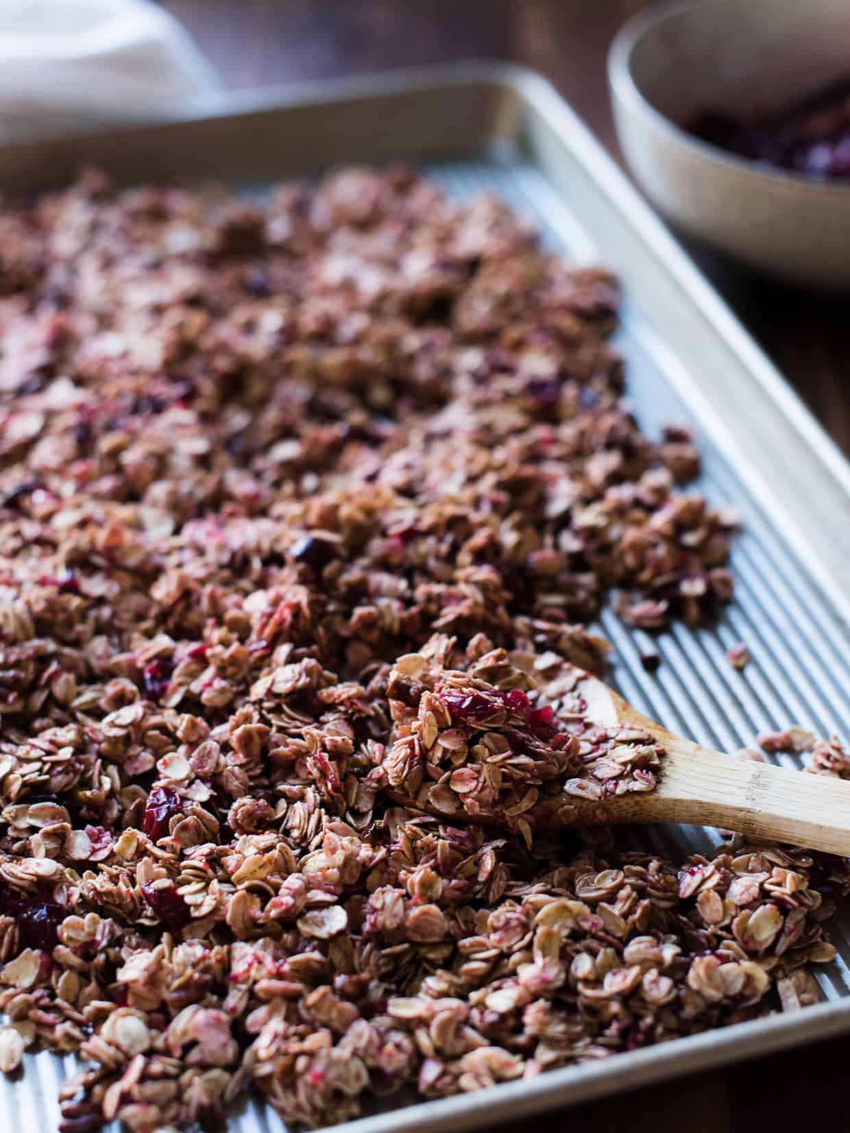 Sheet pan filled with Cranberry Sauce Granola to bake.