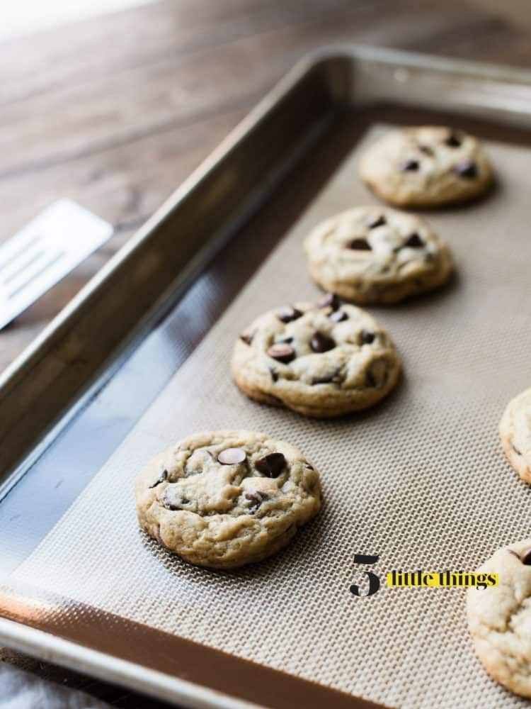 Cream Cheese Chocolate Chip Cookies fresh out of the oven on a baking tray.