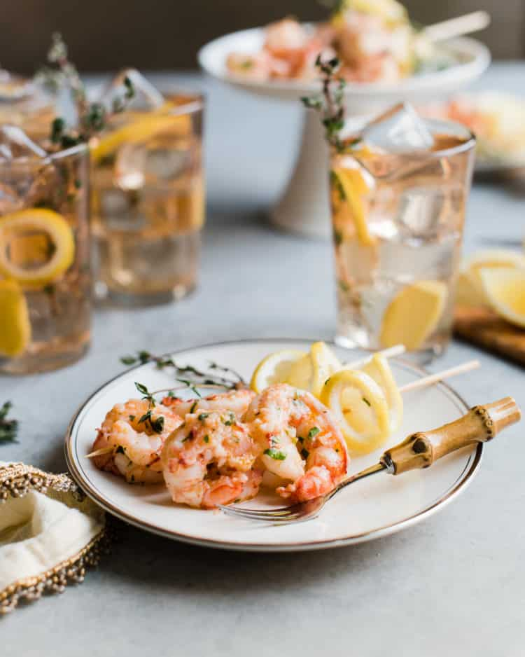 Simple, flavorful and cooks in no time -- Ginger Lemon Shrimp is an easy weeknight meal (just add bread!) or an elegant appetizer!