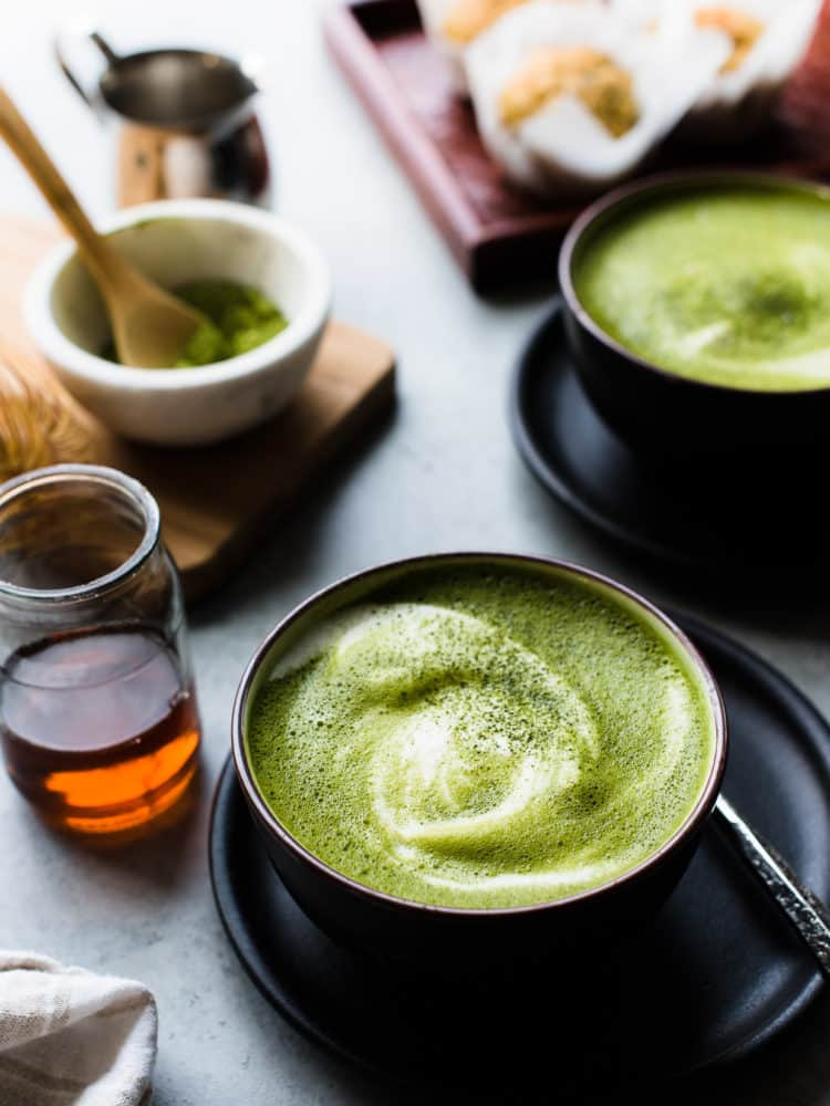There's nothing more cozy than a matcha green tea latte. This latte is made dairy-free with almond milk and sweetened lightly with maple syrup. #matcha #greentea #tea #latte #recipe #vegetarian #vegan