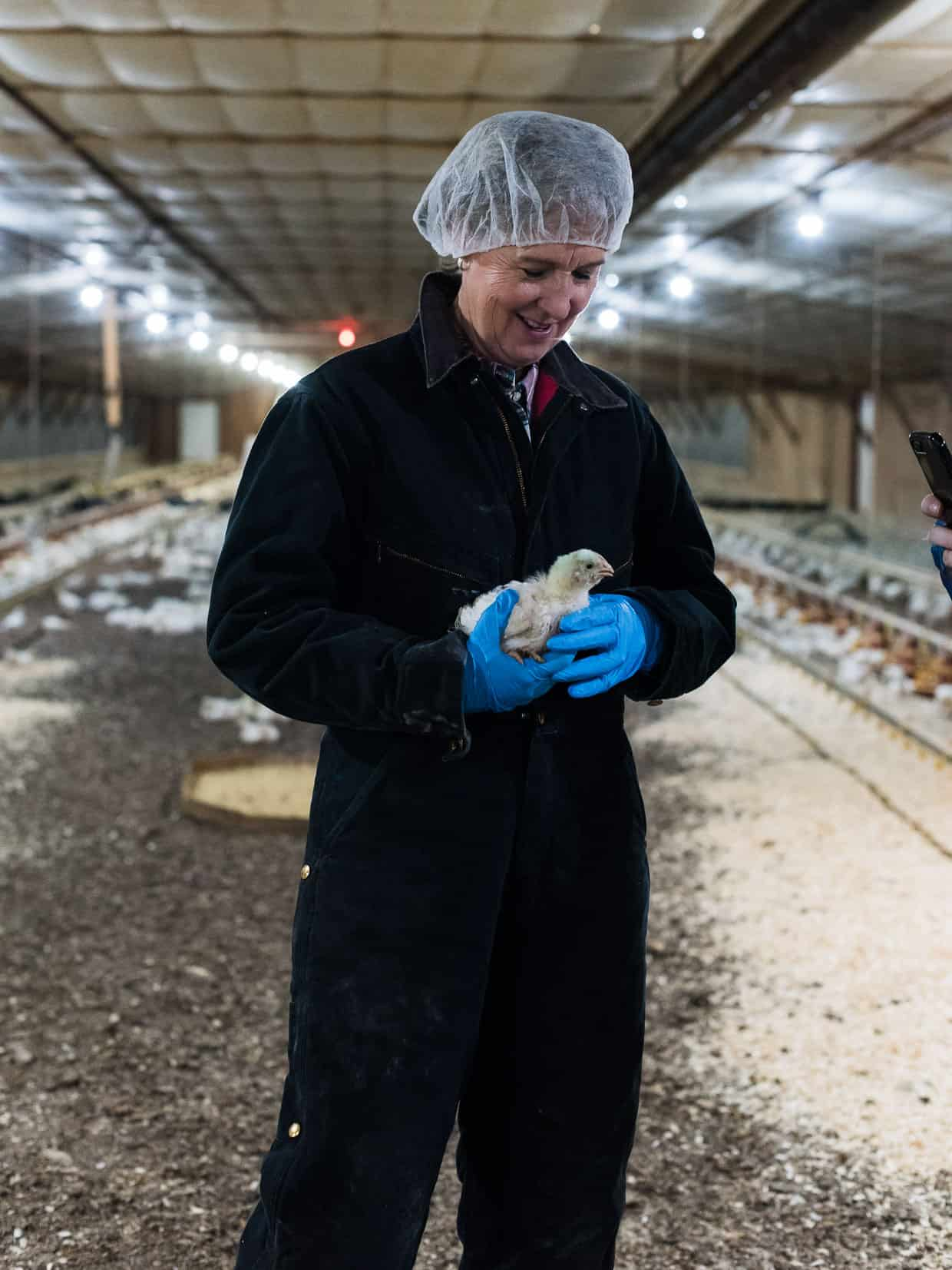 Jenny Rhodes and the chickens she raises. #sponsored National Chicken Council