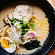 Bowl of ramen with narutomaki, ramen egg, chasu pork.