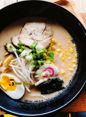 Bowl of ramen with narutomaki, ramen egg, chasu pork.