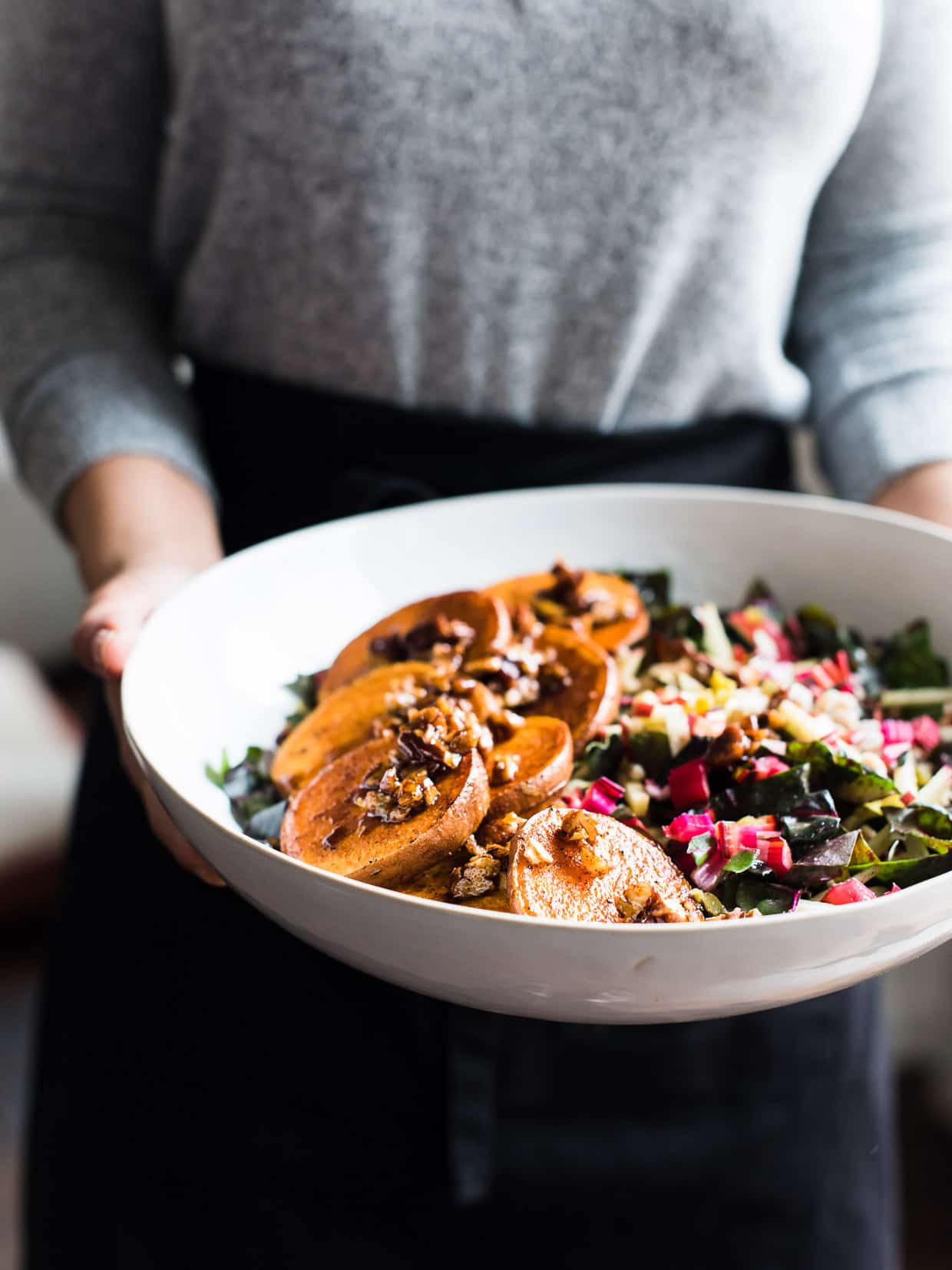 woman holding bowl of Winter Farro Salad with sweet potato and chard from Green Chef