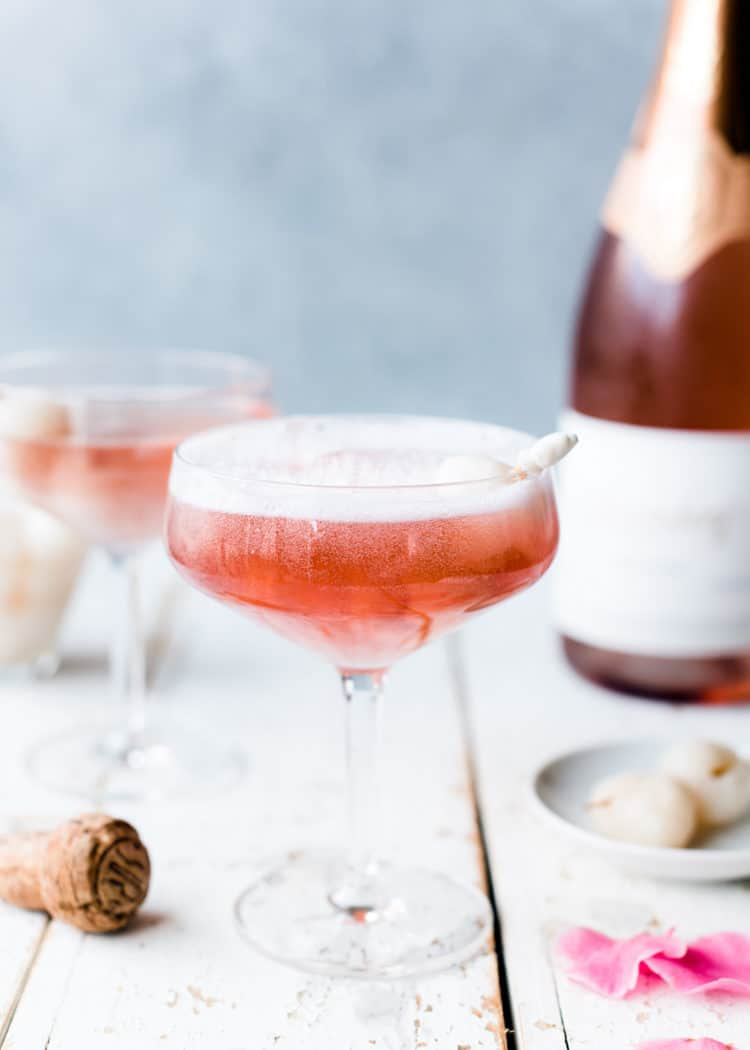 pink mimosa in champagne coupe with lychee and rosewater