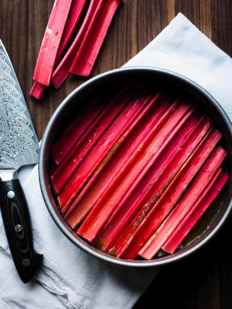 Slices of rhubarb in cake pan for Rhubarb Upside-Down Cake