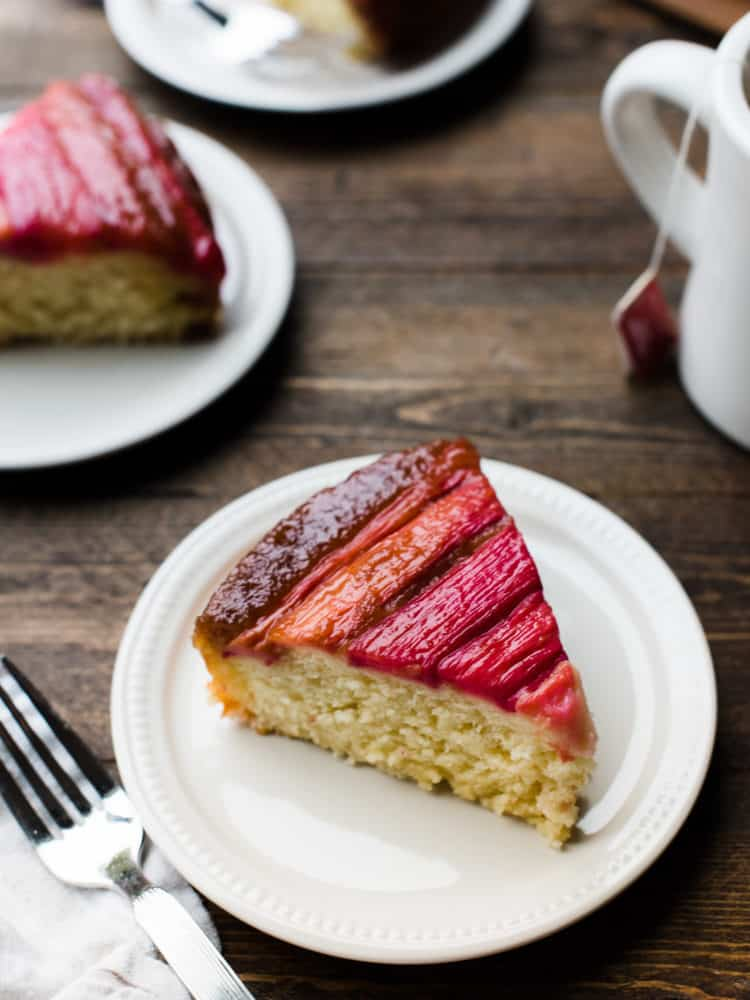 Slices of Rhubarb Upside-Down Cake on brown table.