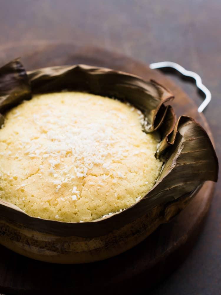 Bibingka - Coconut Rice Cake - baked in banana leaves in terra cotta dish.