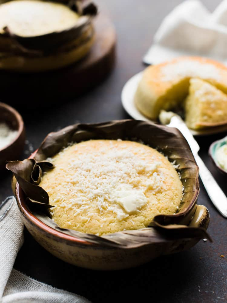 Filipino Coconut Rice Cake, a quickbread baked in banana leaves with grated coconut.