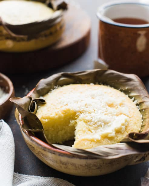 Bibingka Filipino Coconut Rice Bread baked in banana leaves and sprinkled with grated coconut.