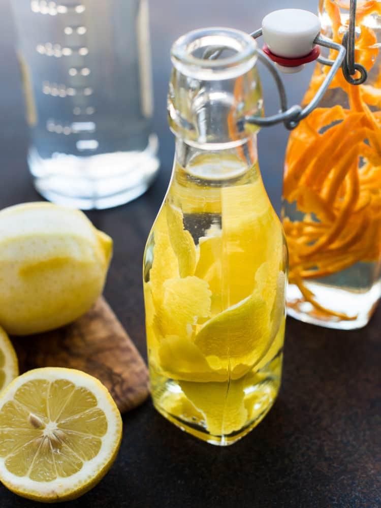 Making homemade lemon extract for baking.