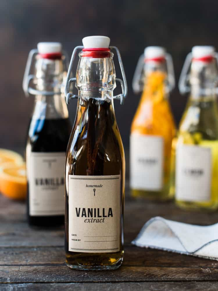 Homemade vanilla extract in a glass bottle with label.