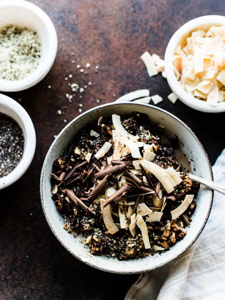 Bowl of Mocha Oatmeal Bowls with oats, espresso, dark chocolate shavings, chia seeds and coconut.