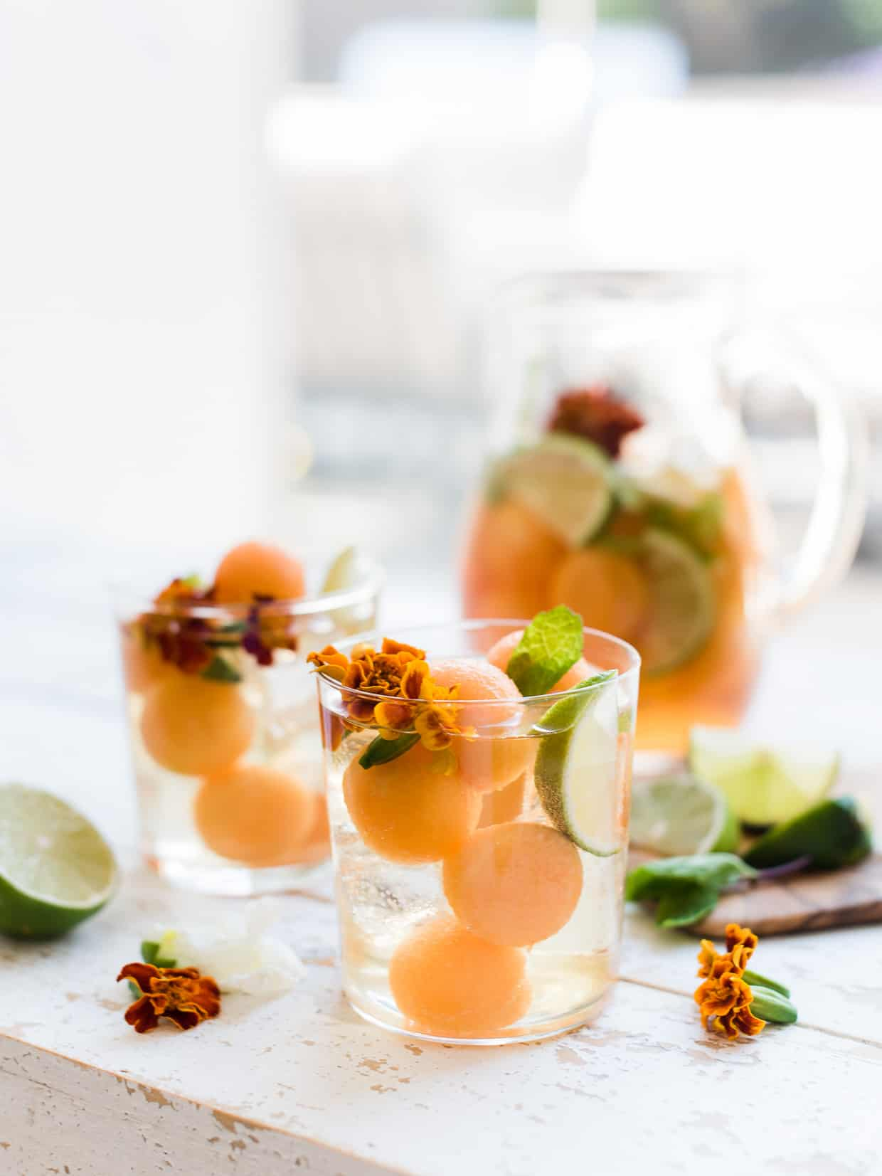 Ginger Cantaloupe Sangria in pitcher and served in glasses.