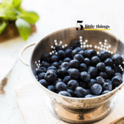 Bowl of blueberries in a colander.