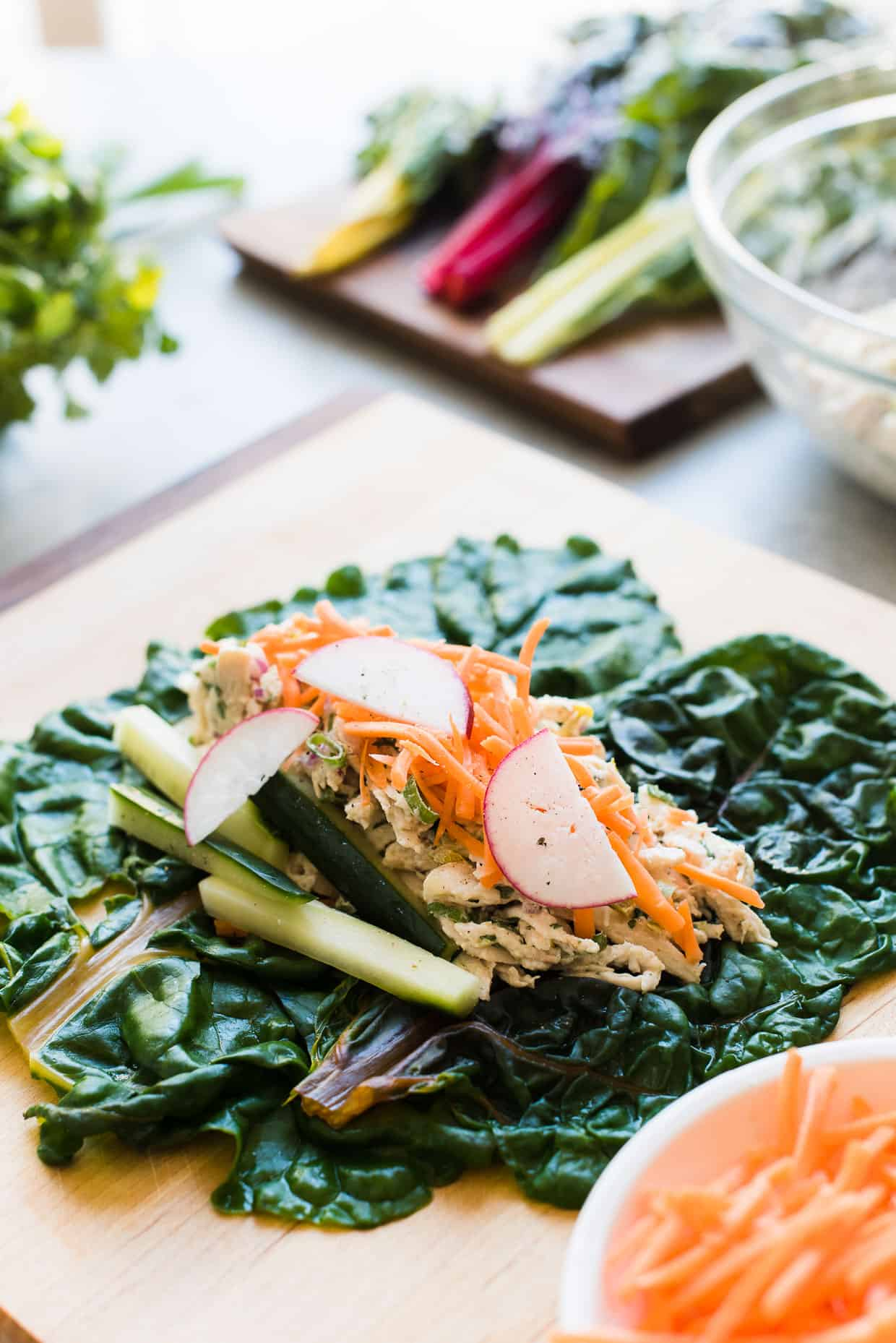 How to wrap Thai-Style Chicken Salad Rainbow Wraps with rainbow chard.
