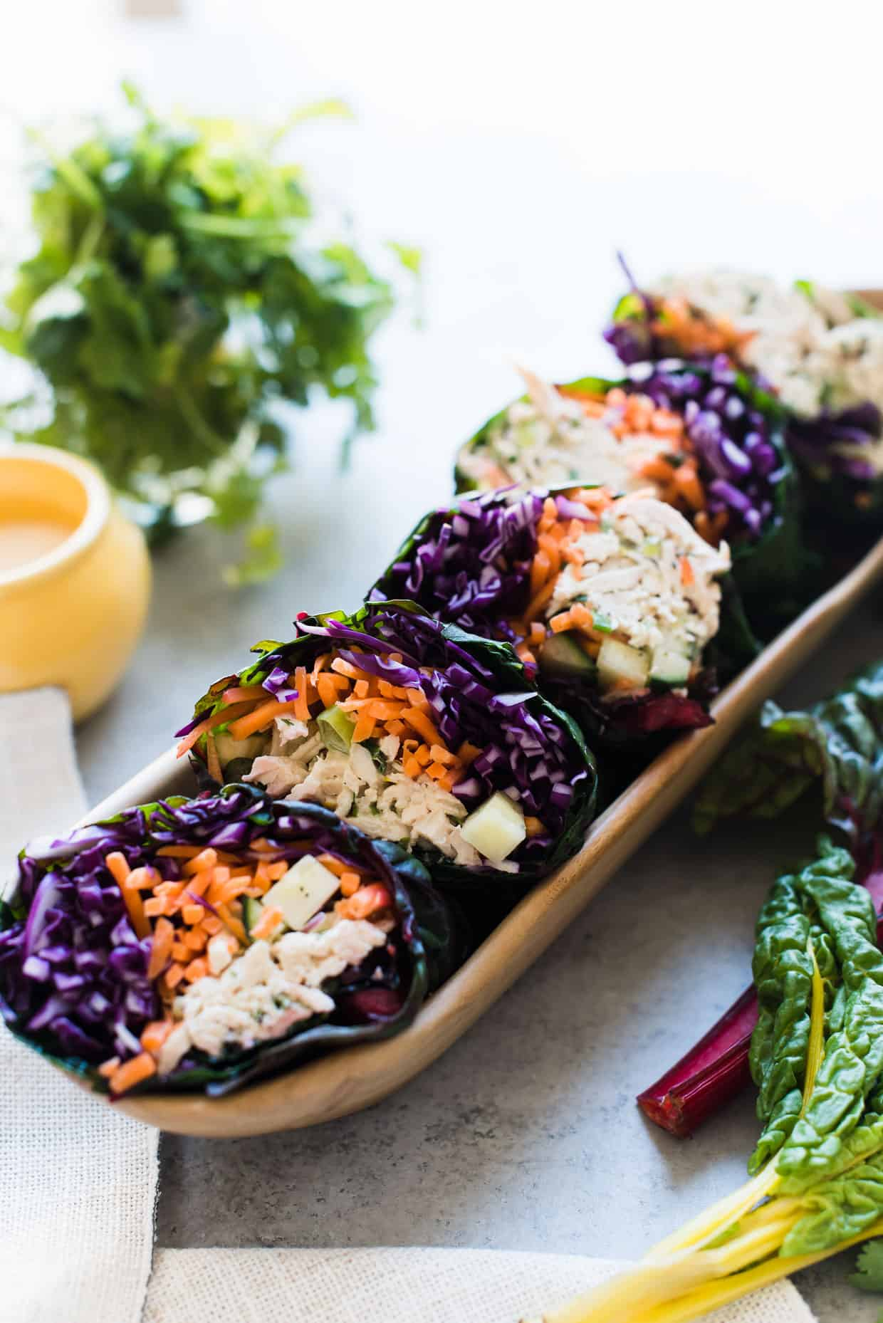 A row of Thai-style Chicken Salad Rainbow Wraps