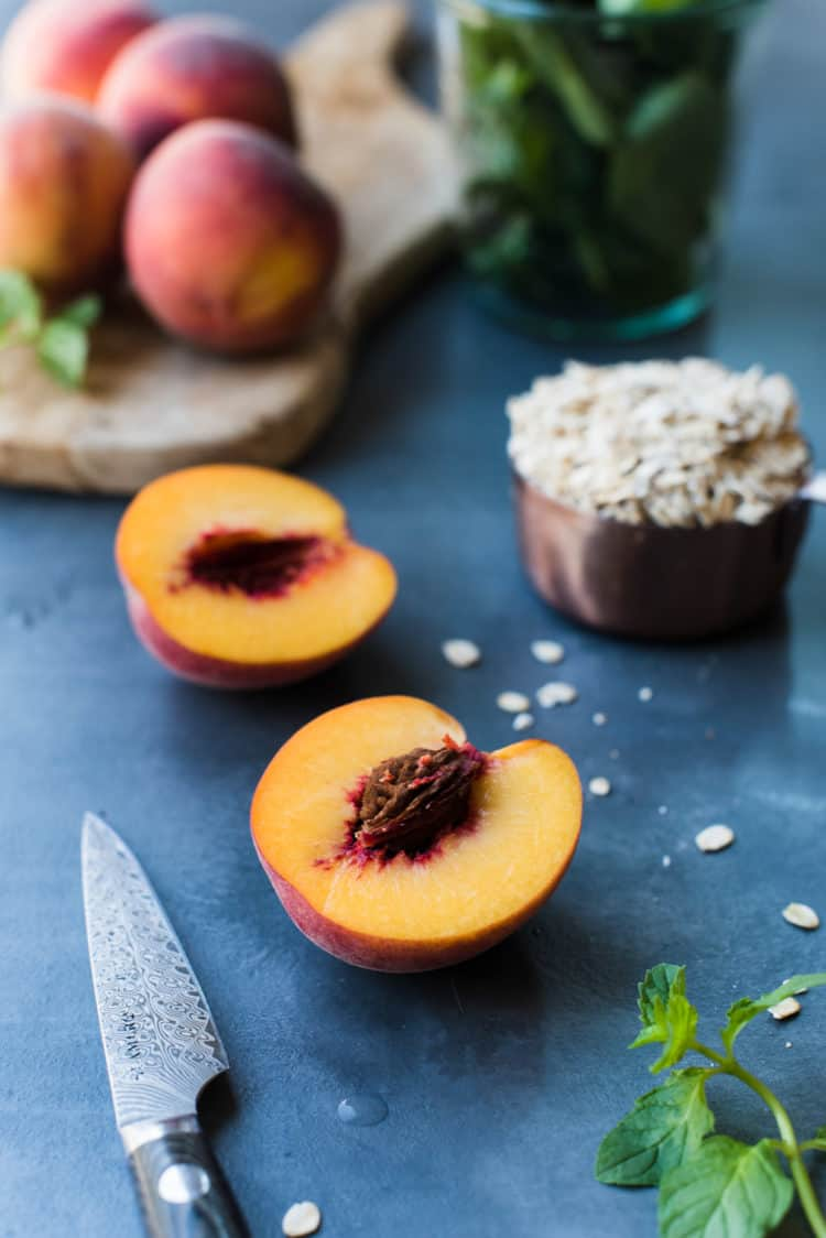 Freshly sliced peach for Peaches and Cream Green Breakfast Smoothie