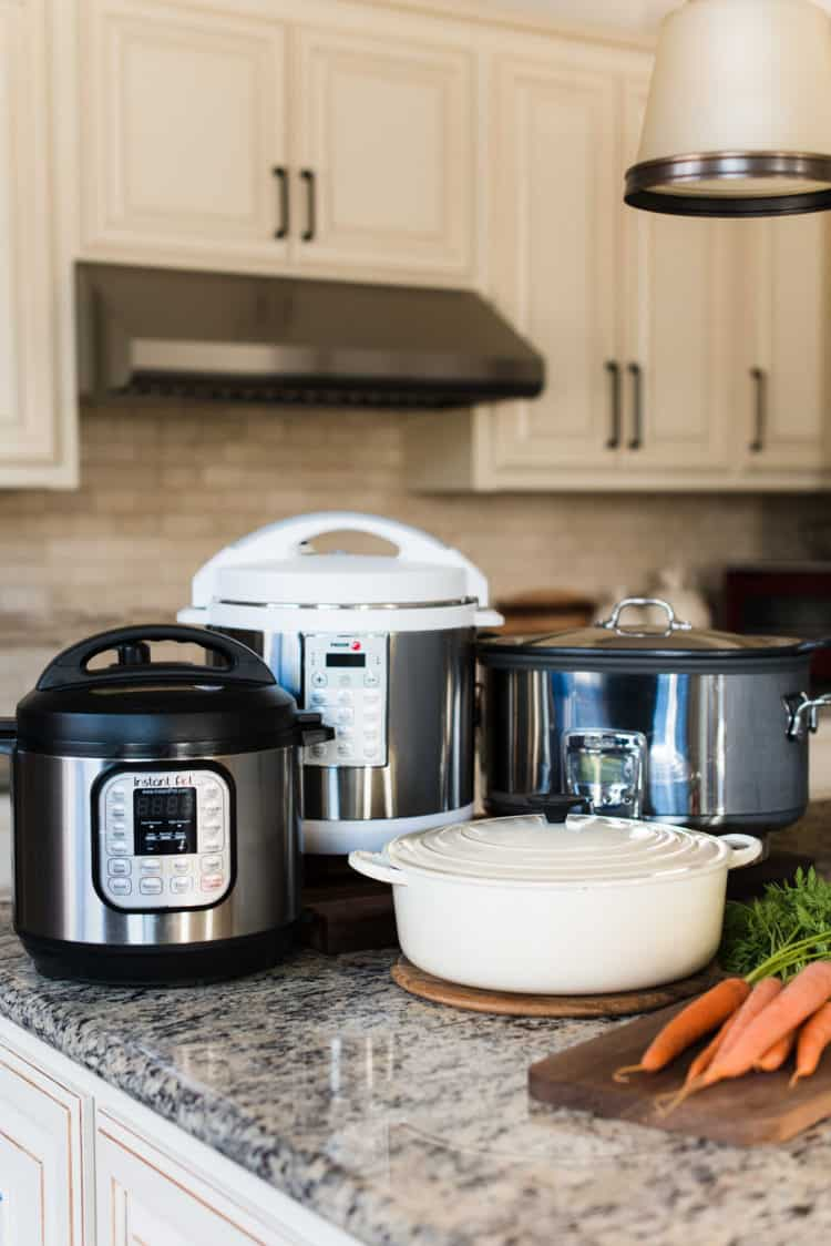 Slow cooker, multicooker, pressure cooker, Dutch oven in kitchen