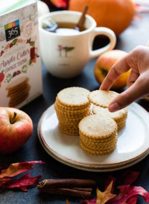 Reaching for a stack of apple cider cookie thins.