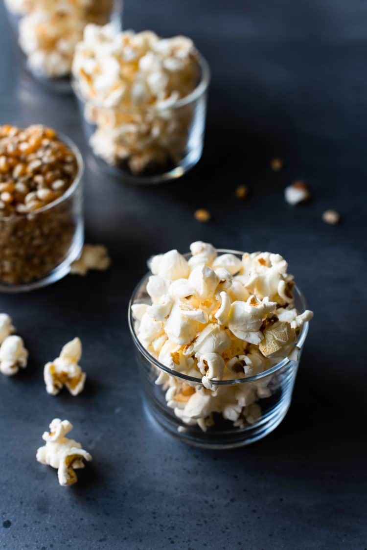Glasses of popped stovetop popcorn, individual serving size.