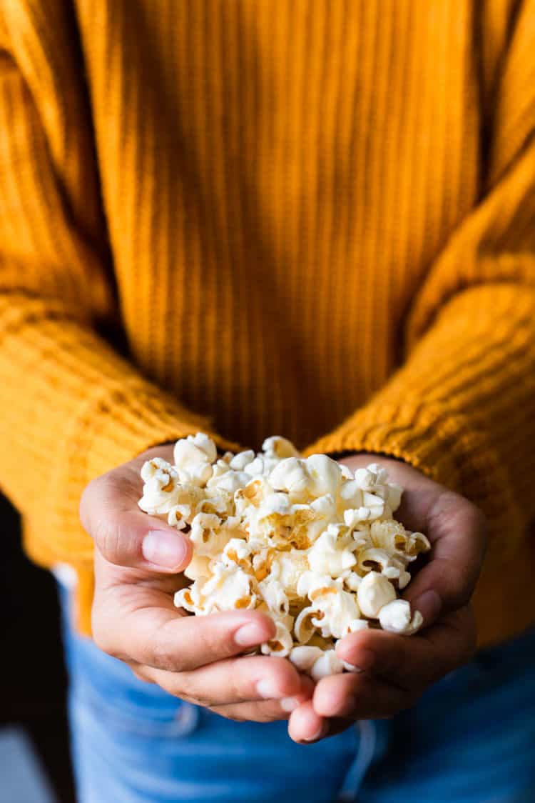 Handful of freshly popped stovetop popcorn.