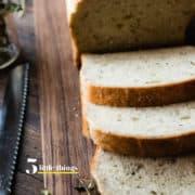 Sliced homemade bread on a cutting board.