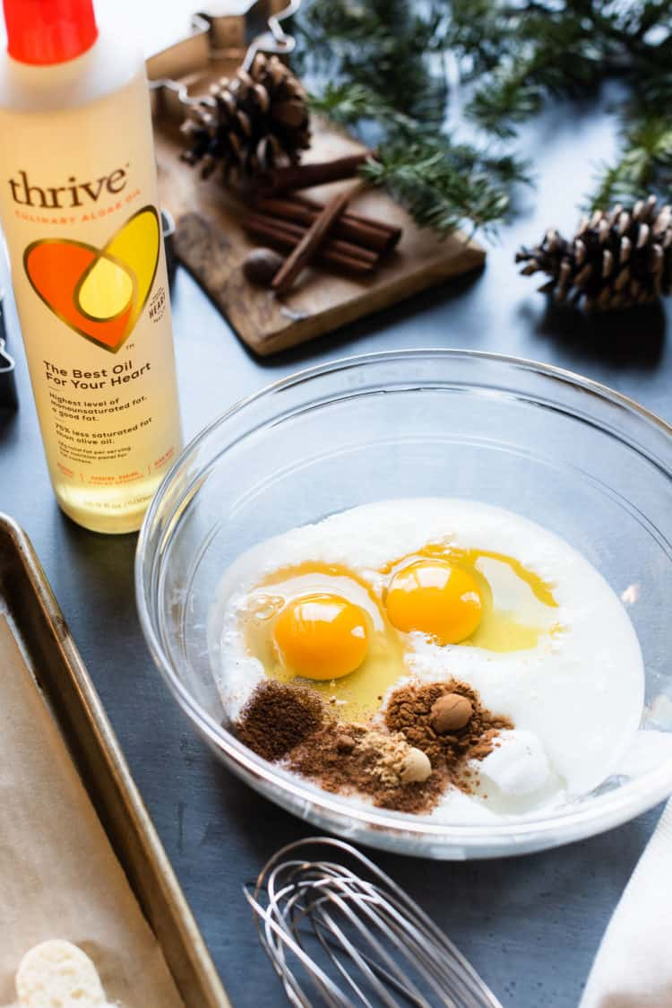 Milk, eggs, and spices in a glass bowl.