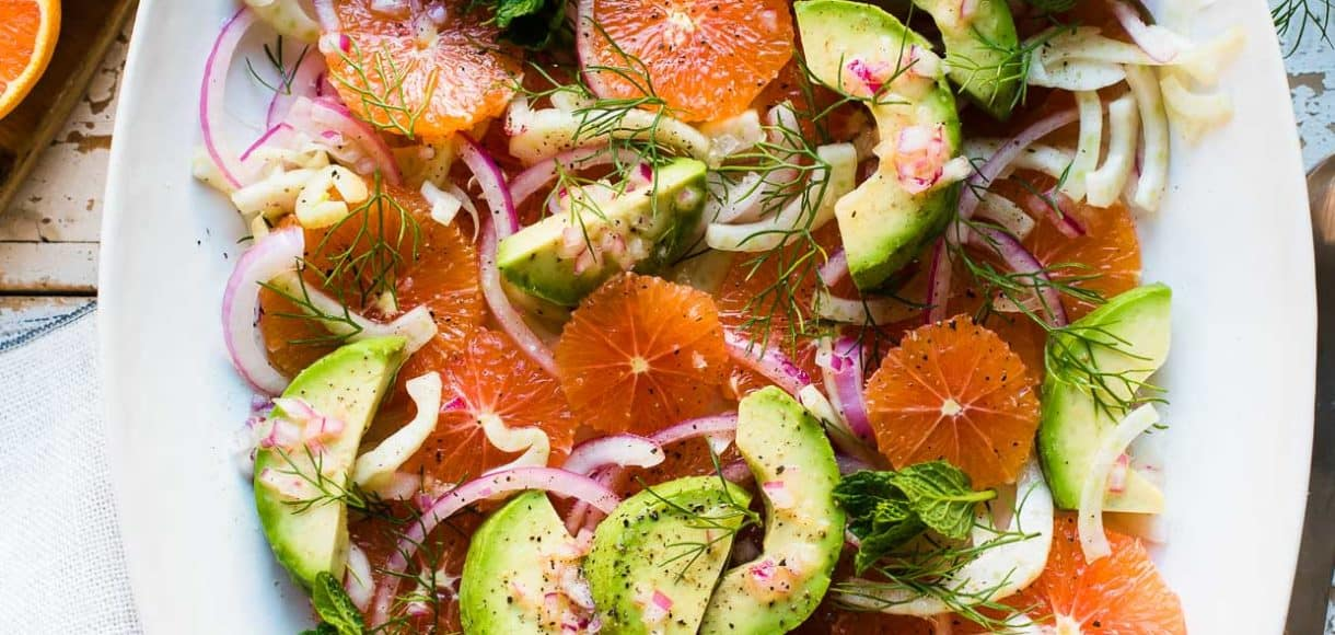 Citrus and Avocado Salad with Quick-Pickled Fennel in a white oval platter.