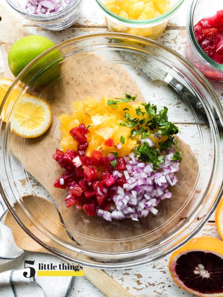 Ingredients for citrus salsa in a bowl.