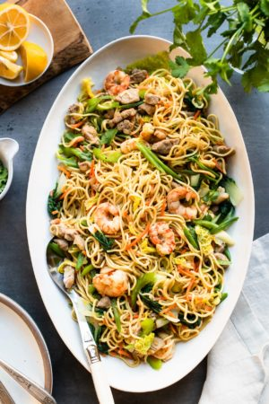 Pancit Canton: Filipino Stir-Fry Noodles with shrimp and vegetables in a white serving platter.