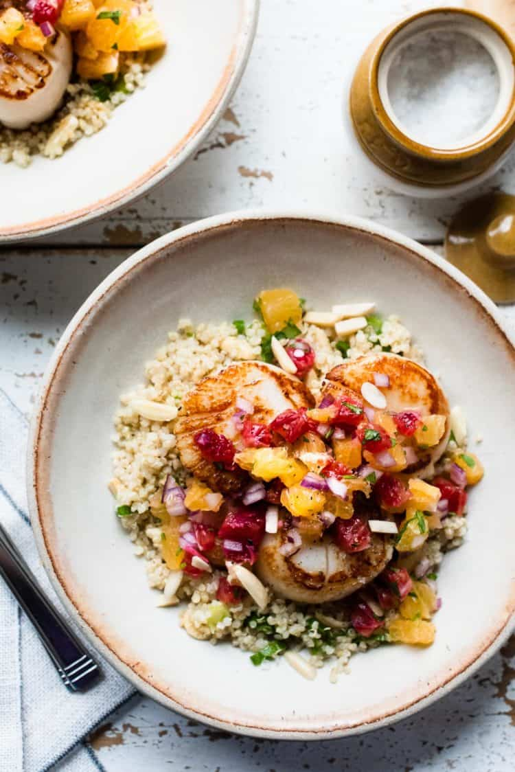 Seared Scallops with Citrus Salsa on a bed of quinoa.