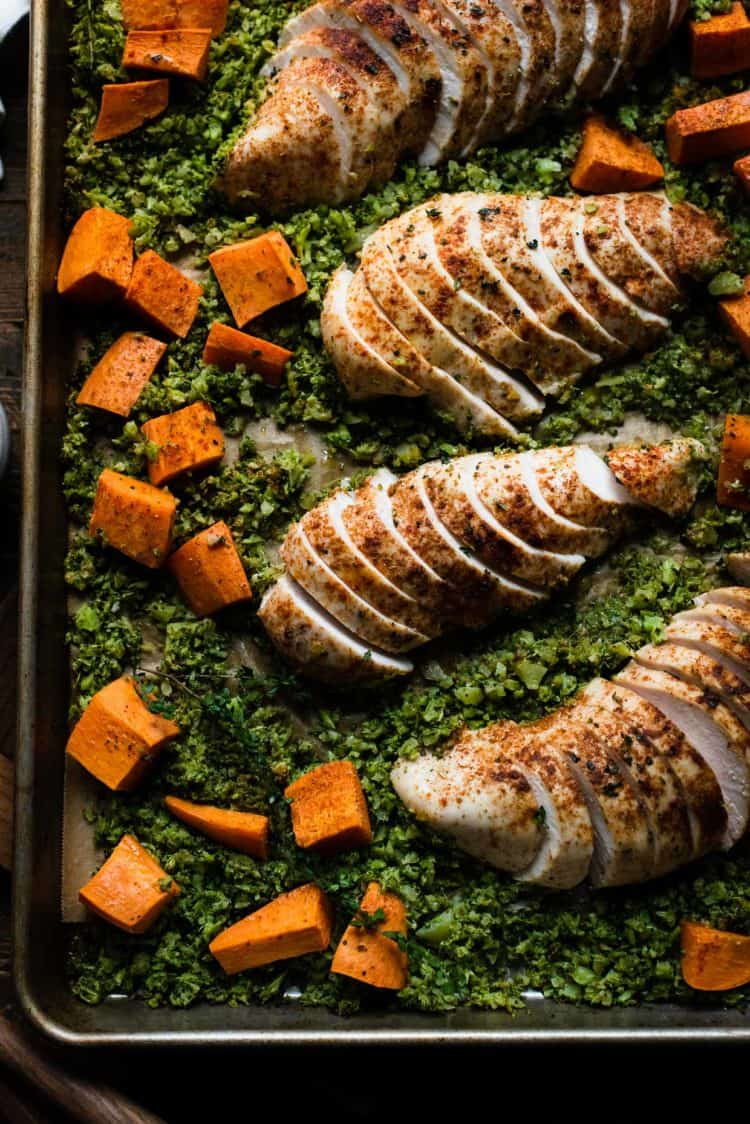 Sheet Pan with sliced Moroccan Chicken, Broccoli Rice and Sweet Potatoes