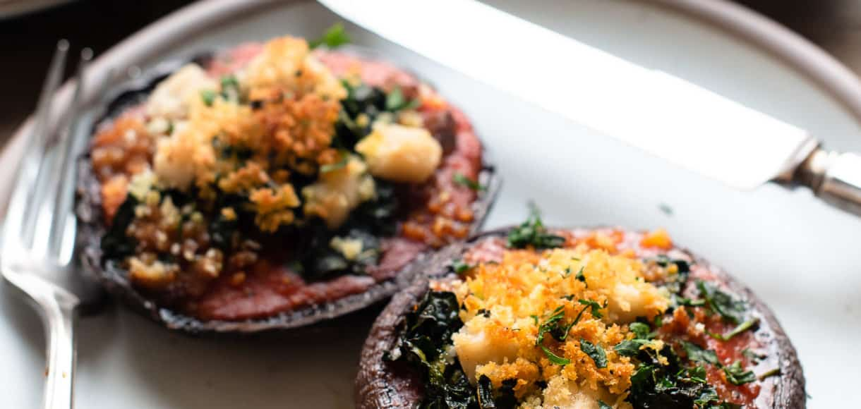 Stuffed Portobello Mushrooms with Garlicky Kale on a plate.
