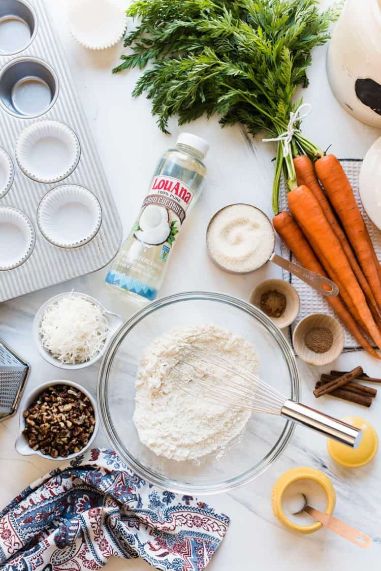 Ingredients for vegan carrot cake cupcakes made with liquid coconut oil.