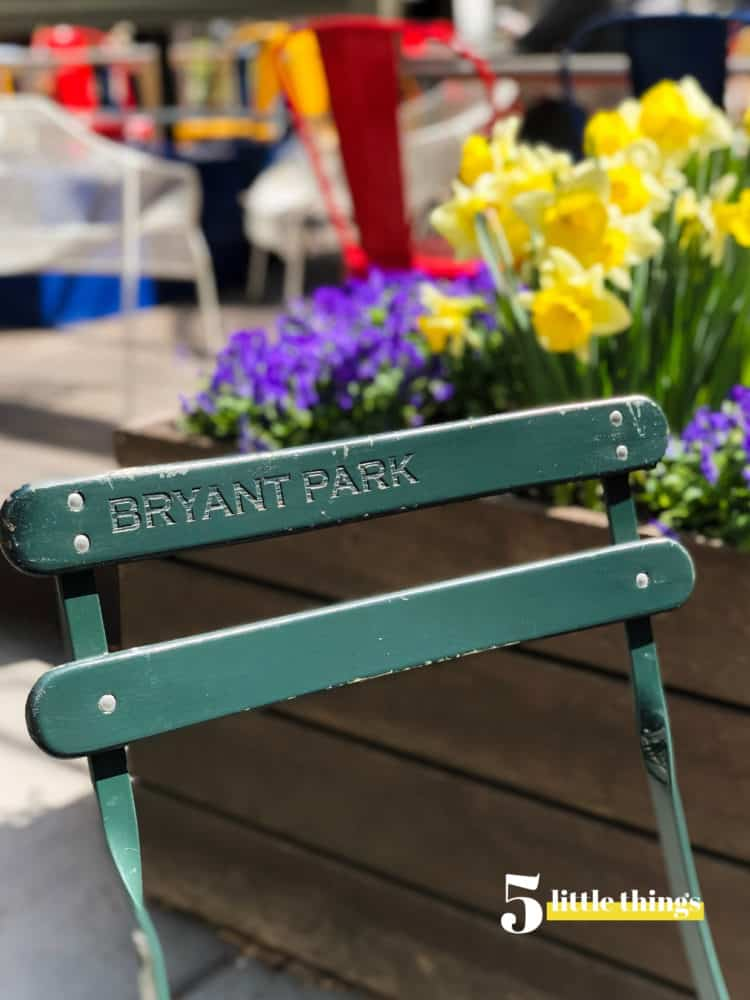 Chair in Bryant Park with spring flowers is one of Five Little Things I loved the week of April 12, 2019.