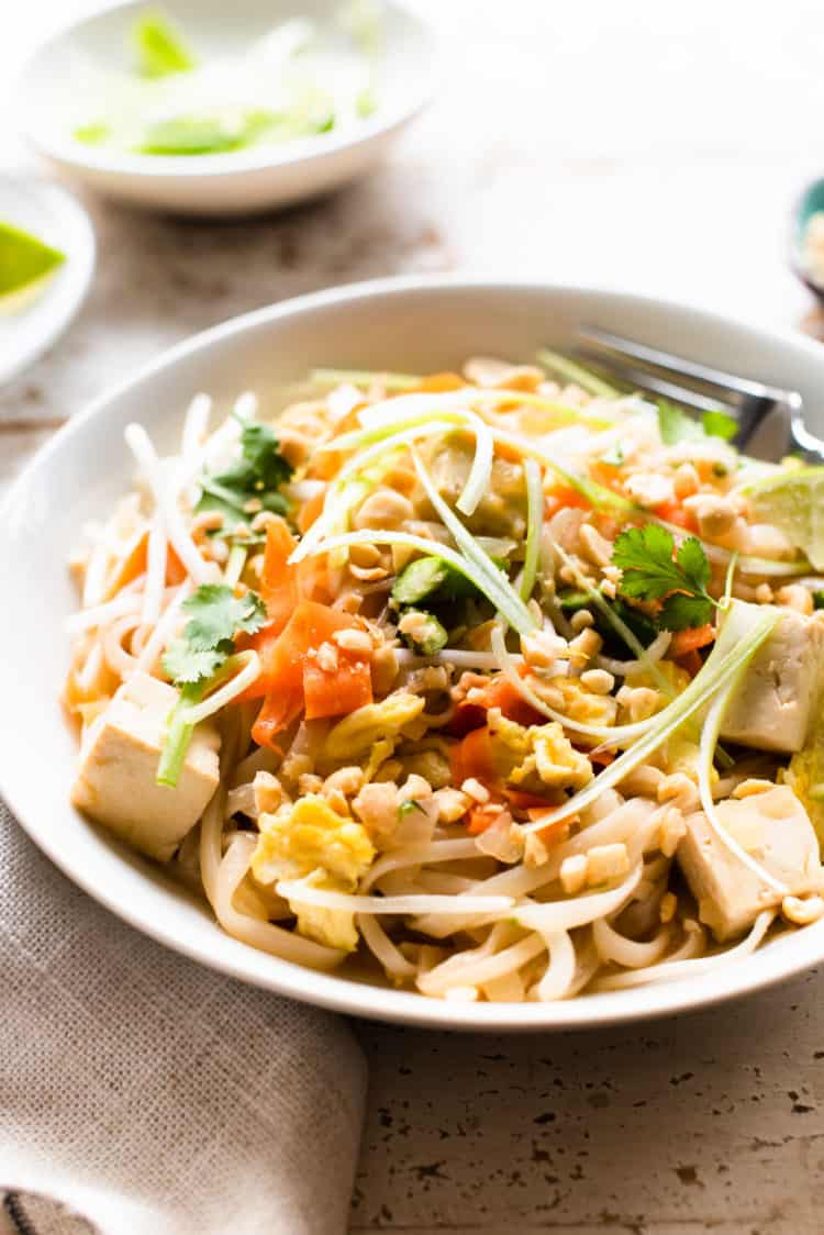 Instant Pot Vegetarian Pad Thai in a bowl garnished with scallions and cilantro.